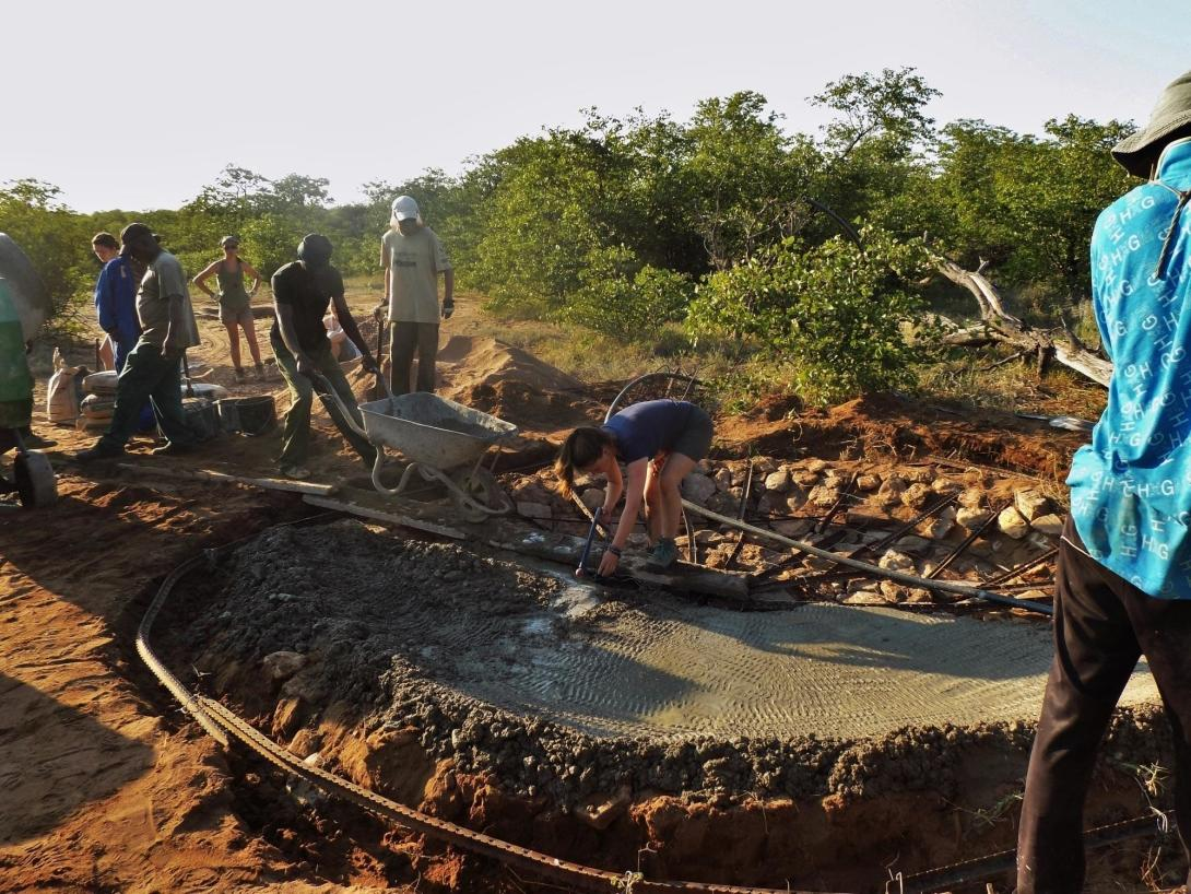 Conservation volunteers take part in the construction of a waterhole at Wild at Tuli game reserve
